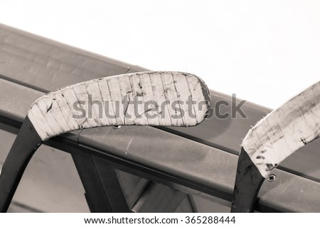 Black and white picture of hockey stick blades