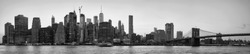 Black and white picture of New York City skyline silhouette at sunset, USA.