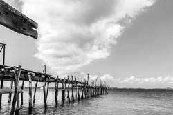 black and white picture of old bridge to the sea