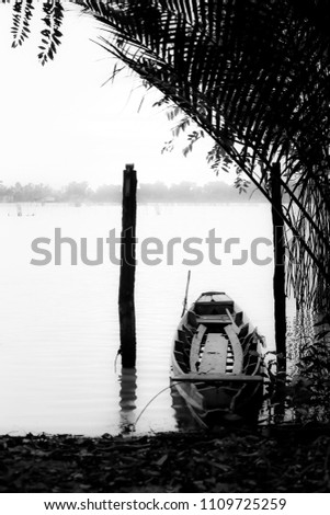 Black and white picture small boats in the sea.