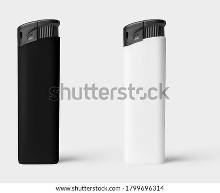 Black and white plastic lighter on white background ストックフォト ©