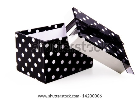 Black and white polka dotted gift box.  The lid is off and leaning to the side.  The top has a black ribbon and bow. Isolated on white.