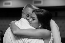 black and white portrait dance of the bride with father.Emotional crying girl hugging father on the day of wedding. Emotional father hugg daughter on the day of wedding.tears of happiness in the bride