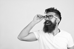 Black and white portrait of a Bearded Man in white T-shirt and glasses on toned background. There is a space for your text. Good advertising of your products, autumn sale, discount, Black Friday.