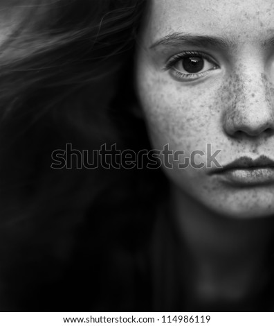 black and white portrait of a beautiful girl with freckles