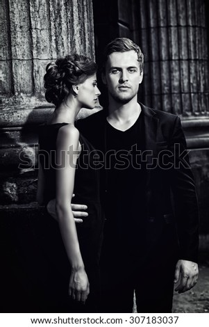 Black-and-white portrait of a beautiful man and woman. Fashion style photo. Love concept.