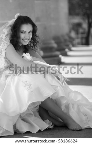 black and white portrait of a bride in theater columns