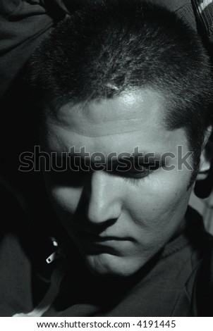 Black and white portrait of a depressed young man