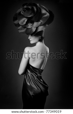 black and white portrait of a girl in a dark roses suit - stock photo