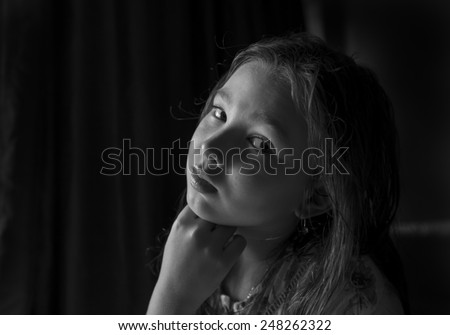 Black and white portrait of a pensive girl