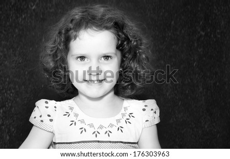 Black and white portrait of a smiling girl with curly. #176303963