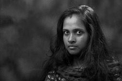 Black and white portrait of a woman of Indian subcontinent