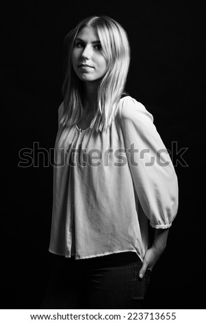 Black and white portrait of a young blonde girl with nose piercing