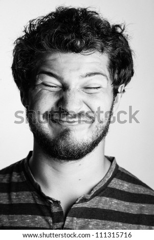 Black and White Portrait of a Young College Boy in a Striped Tee Shirt wth his eyes shut