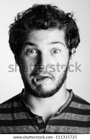 Black and White Portrait of a Young College Boy making a silly face