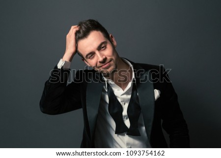 c49a863450be Black and white portrait of a young handsome man in a suit, smiling and  looking