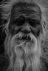 black and white portrait of an old man / monk / old bearded man