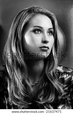 Black and white portrait of beautiful woman with flowing hair
