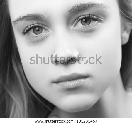 Black and white portrait of beautiful young woman, close up