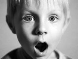 Black and white portrait of cute caucasian boy