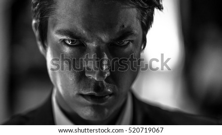 Black and white portrait of focused man #520719067
