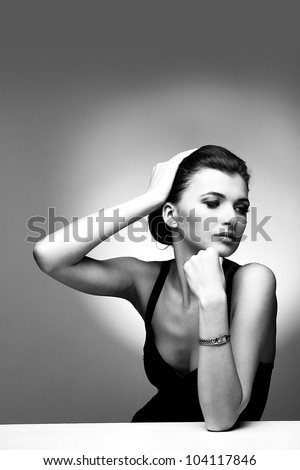 Black and white portrait of luxury woman in exclusive jewelry on natural background