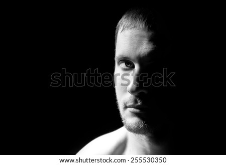 Black and white portrait of man on a black background