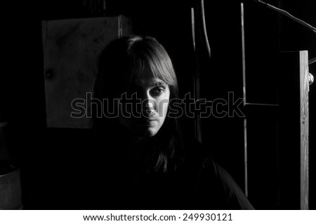 Black and white portrait of man on electric chair  . Dramatic studio lighting