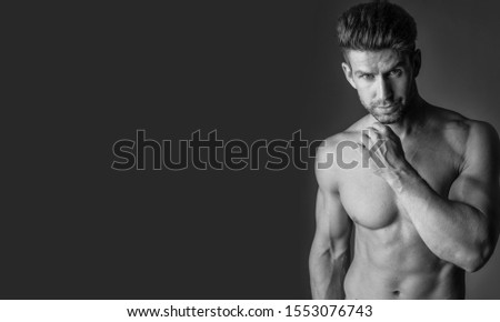 Black and white portrait of muscular man.