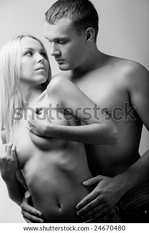 Black and white portrait of naked couple during foreplay