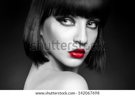 black and white portrait of pretty young brunette in studio