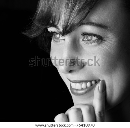 black and white portrait of smile woman.