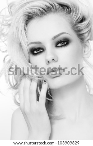Black and white portrait of young beautiful girl with stylish make-up and long hair