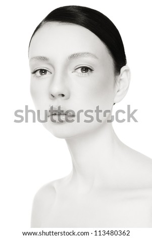 Black and white portrait of young beautiful woman with clear make-up over white background