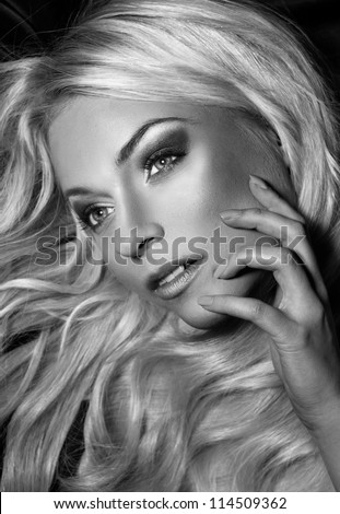 black and white portrait of young beautiful woman with long blond hair. blond