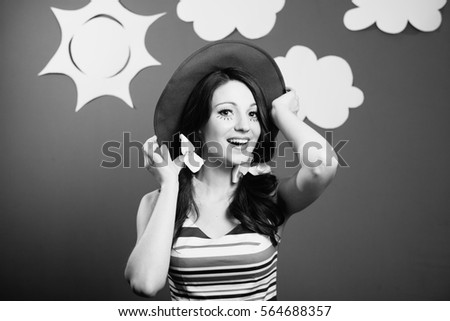 Black and white portraitt of amazed excited young woman actress on the theatrical play handmade sky background #564688357