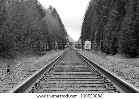 black and white railway tracks bridge