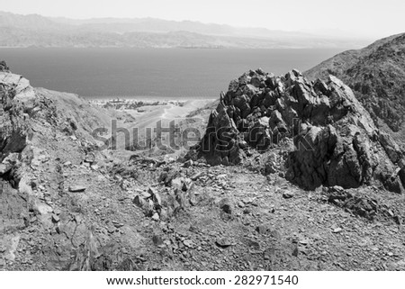 Black and white Red sea mountains and Eilat  Aqaba city view, Israel.