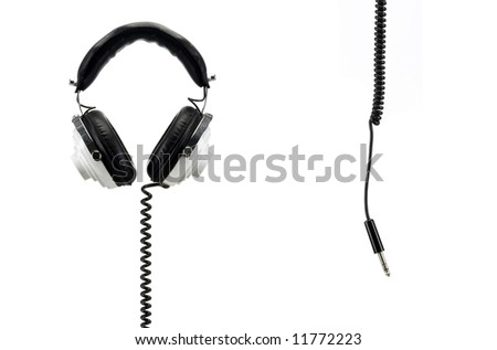 Black and white retro headphones isolated on white with jack hanging from the top