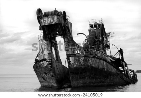 Black and white ship wreck - formally a dredge.