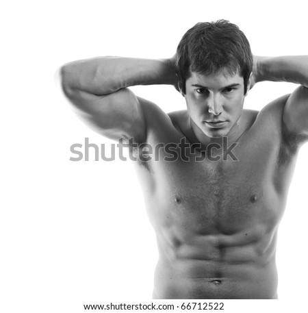Black and White shot of muscular young man on white background