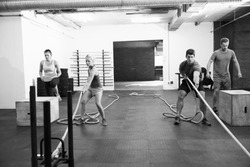 Black And White Shot Of People In Gym Circuit Training
