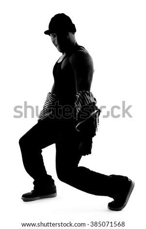 Black And White Silhouette Of A Male Dancer Posing With Dance Moves He Is Backlit