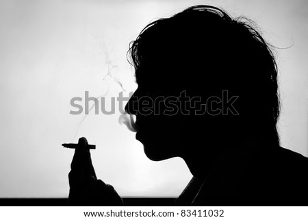 Black and white silhouette of smoking young man