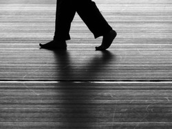 black and white silhouette walking on the floor
