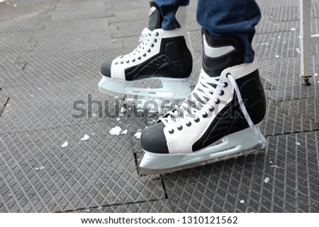 black and white skates for skating on ice in winter and figure skating, the theme of sport and recreation #1310121562