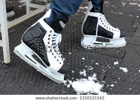 black and white skates for skating on ice in winter and figure skating, the theme of sport and recreation #1310121565