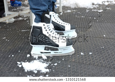 black and white skates for skating on ice in winter and figure skating, the theme of sport and recreation #1310121568