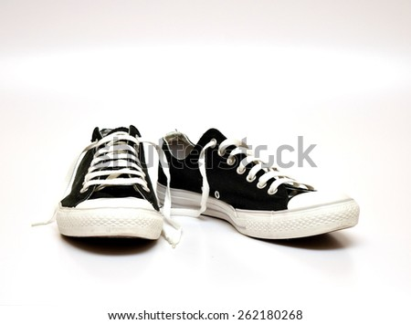 black and white sneakers shoes isolated on white background #262180268