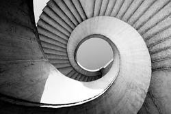 Black and white spiral stairs abstract design. Round steps near the Gdanski bridge in Warsaw, Poland
